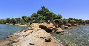 Panorama of the stone ledge in the Aegean Sea. Stock Photo