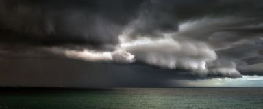Panorama of stormy clouds. On the sea stock photography