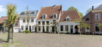Panorama Street view of the historical houses at Harderwijk. Panorama Street view of the historical houses at the `Smeepoortenbrink` is the streetname in the Stock Photo