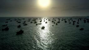 Golden Sunset Illuminates Way for Fishing Boats. Panorama stunning golden sunset reflects path on sea surface illuminating way for fishing boats stock footage