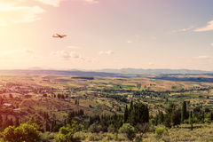 Panorama of the suburbs of the Greek city of Athens with landing plane at sunset Royalty Free Stock Image