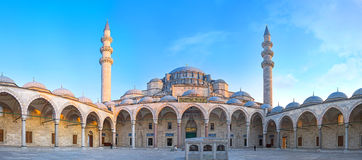 Panorama of the Suleymaniye Mosque. ISTANBUL, TURKEY - JANUARY 21, 2015:Panorama of the huge courtyard of the Suleymaniye Mosque with the ablution fountain Royalty Free Stock Photos