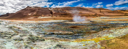 Panorama of sulfur and steam Namafjall landscape in Iceland Royalty Free Stock Images