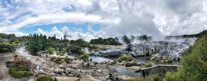 Panorama of Sulphur and silica geothermal deposits and Pohutu geyser. Yellow sulphur geothermal deposits and Pohutu Geyser Rotorua - travel destination in royalty free stock photos