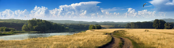 Panorama of the summer day with little river Royalty Free Stock Photography