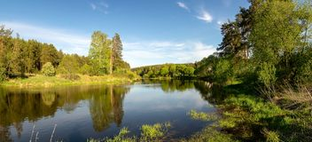 Panorama of the summer landscape on the Bank of the Ural river with forest, Russia,. August stock images