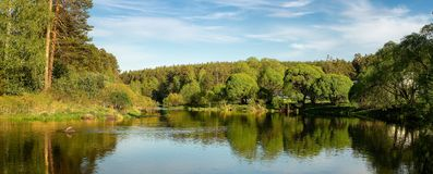 Panorama of the summer landscape on the Bank of the Ural river with forest, Russia,. August stock photo