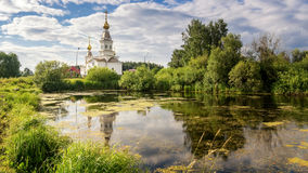 Panorama of a summer landscape with a lake and the white Church on the Bank of Russia, the Urals Royalty Free Stock Images