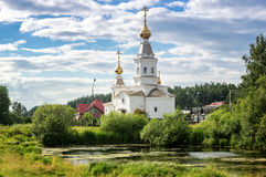 Panorama of a summer landscape with a lake and the white Church on the Bank of Russia, the Urals Royalty Free Stock Photo