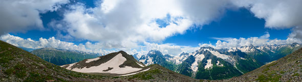 Panorama of Summer Mountains in Caucasus. View from mount Musa Achitara. Dombai, Russia royalty free stock image