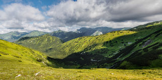 Panorama of summer mountains under blue cloudy sky. West Tatras, Slovakia, Europe Stock Photos