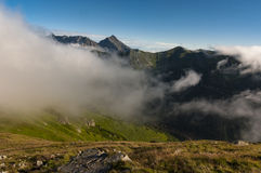 Panorama of summer mountains under the clouds.  Stock Image