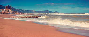 Panorama of the summer sunny morning on the Meditheranian beach Royalty Free Stock Photo