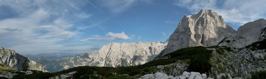 Panorama with summit of Stenar above Vrata valley in Triglav national park in Julian Alps in Slovenia Stock Photos