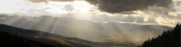 Panorama of sun rays on the valley Stock Images