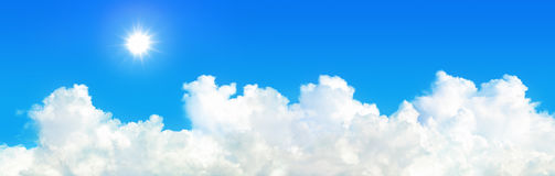 panorama of sun shines with white cloud on blue sky stock photo