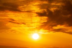 Panorama of sun shining on sky and clouds background sunrise or sunset scene. Panorama of Golden hour orange sky with clouds and the yellow sun shining nature stock photography