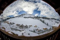 Panorama of the sunny mountain with some clouds. Perfect morning view during the winter ! a panorama fron french chalet in french alps stock image
