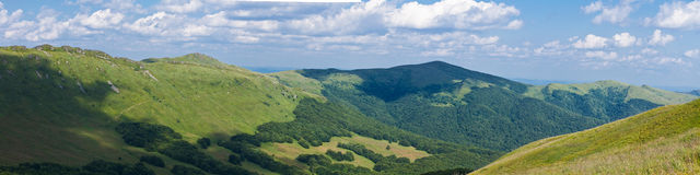 Panorama of sunny top of a mountains Royalty Free Stock Photography