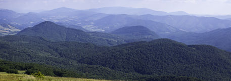Panorama of sunny top of a mountains Royalty Free Stock Image