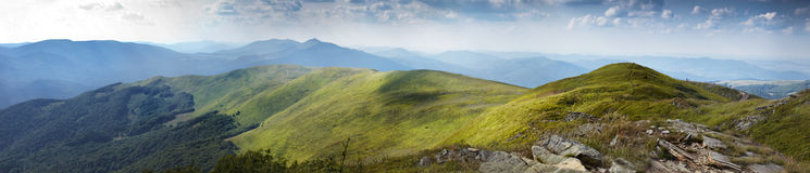 Panorama of sunny top of a mountains Royalty Free Stock Images