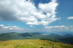 Panorama of sunny top of a mountains Stock Photo