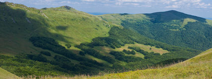 Panorama of sunny top of a mountains Stock Photos