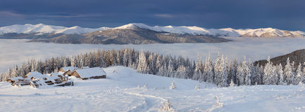 Panorama of sunny winter landscape in the mountains Royalty Free Stock Photos
