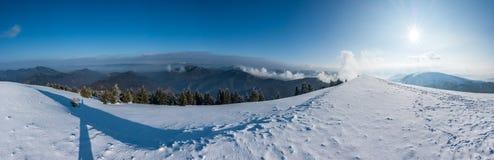 Panorama of sunny winter mountains Stock Image