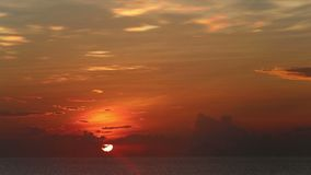 Sunrise from behind clouds at beach. Panorama of sunrise from behind clouds at beach of vietnamese resort city stock video