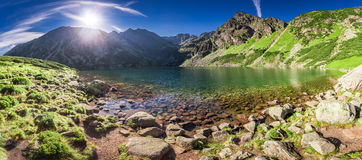 Panorama of sunrise at Czarny Staw Gasienicowy in Polish Mountains. Europe Stock Photography