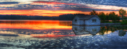 Panorama of a sunrise on a lake Stock Photos