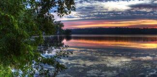 Panorama of a sunrise on a lake Stock Image