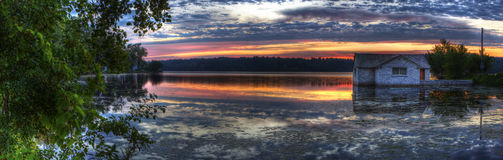 Panorama of a sunrise on a lake Stock Images