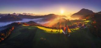 Aerial sunrise view of Saint Tomas church, Slovenia. Natural panorama. stock photo