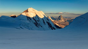 Panorama of sunrise at Monte rosa glacier with Lyskamm and Matte. Sunrise panorama from Monte rosa glacier with view on Lyskamm and Matterhorn Stock Photography