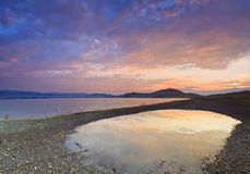 Panorama of the sunrise. Over the lake Stock Image