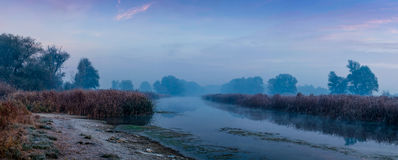 Panorama of sunrise. Over the river and fog Stock Image