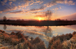 Panorama of sunrise on the river Stock Photo