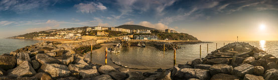 A panorama of the sunrise at Ventnor, Isle of Wight. A Panorama of Ventnor on the Isle of Wight looking from the sea Royalty Free Stock Images