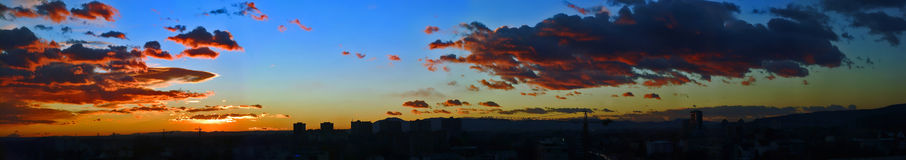 Panorama sunset. With beautifully blue sky and red clouds royalty free stock images