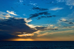 Panorama of a sunset on a calm sea Stock Photography