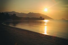 Panorama of sunset on Koh Pha Ngan island, Thong Sala beach, Thailand. Silhouette view Royalty Free Stock Photos