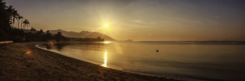Panorama of sunset on Koh Pha Ngan island, Thong Sala beach, Thailand. Silhouette view Royalty Free Stock Photography