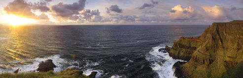 Panorama of the sunset and Lacada Point - part of the Giant's Causeway Royalty Free Stock Photography