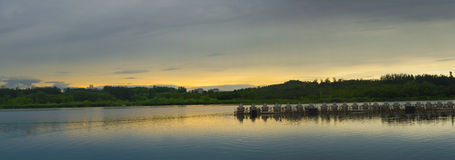 The panorama of Sunset over lake Stock Photos