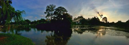 Panorama - sunset over pond Royalty Free Stock Photos