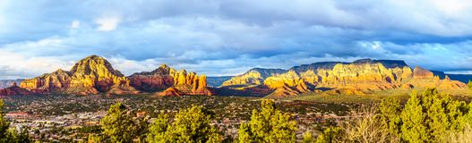 Panorama of a Sunset over Thunder Mountain and other red rock mountains surrounding the town of Sedona, Arizona. Panorama of a Sunset over Thunder Mountain and royalty free stock photo