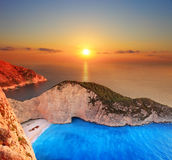 Sunset over Zakynthos. A panorama of sunset over Zakynthos island with a shipwreck on the sandy beach Stock Photography