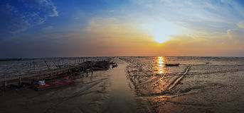 Panorama,sunset in the sea with during low tide. Royalty Free Stock Photos